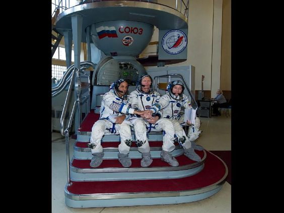 Expedition 31 NASA Flight Engineer Joe Acaba, Soyuz Commander Gennady Padalka and Flight Engineer Sergei Revin pose for photos before their final qualification test in preparation for flight, April 24, 2012 at the Gagarin Cosmonaut Training Center in Star City, Russia. Acaba, Padalka and Revin are set to launch to the International Space Station May 15 from the Baikonur Cosmodrome in Kazakhstan. Photo credit: NASA/Carla Cioffi