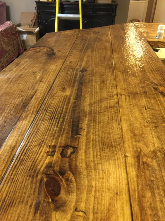 For the bar top, I also took a hammer and chisel to the wood before staining and epoxying it to give it that old barn wood appearance :)