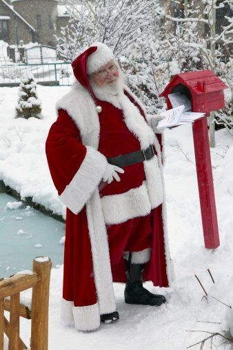 Ho, ho, ho.  Santa checks the mail box.: