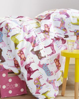 My inner six year wants the outer twenty-six year old to buy this for her. The twenty-six year old kinda wants it too...  Painted Ponies Percale Bedding - Garnet Hill