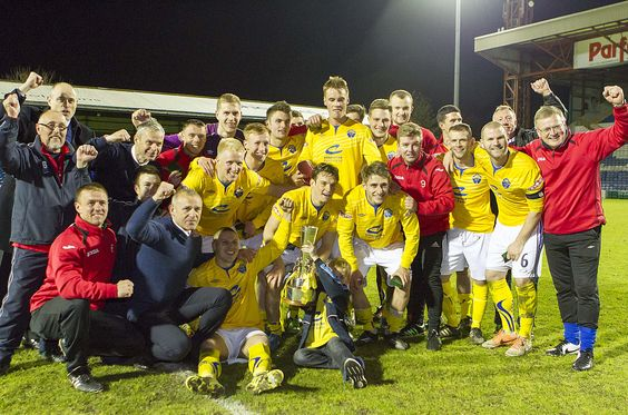Warrington Town FC celebrate winning the Doodson Cup after beating Farsley on penalties