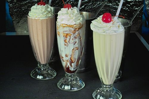 Milkshakes with cherries.