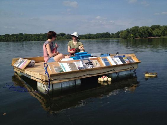ukeleles on the lake with the floating library: