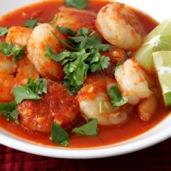Shrimp in a spicy tomato chipotle sauce with cilantro and lime