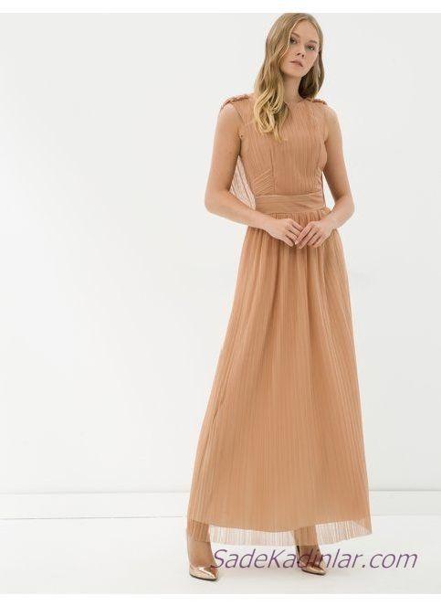 Koton Abiye Elbise Modelleri Ten Rengi Uzun Kolsuz Kapali Yaka Pileli Etek Detay Elbise Modelleri Elbise Pileli Etek