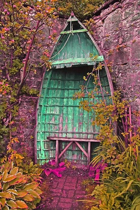 Oh mercy...boat turned into a garden nook...straight out of a fairytale!