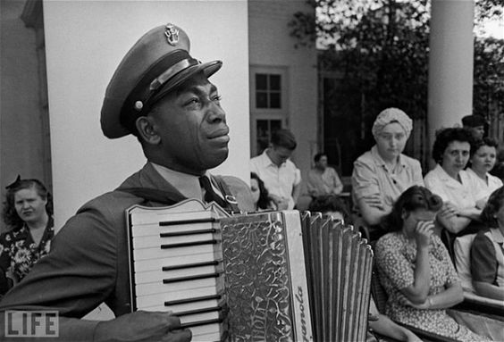 Navy Chief Petty Officer Graham Jackson had played the accordion often for Franklin D. Roosevelt during the polio-stricken president's frequent visits to the spa at Warm Springs, Ga. He was scheduled to play for him again on April 12, 1945, the day Roosevelt died at the LIttle White House in Warm Springs. Instead, the officer found himself leading the funeral procession the next day, tears streaming down his face. By Ed Clark.