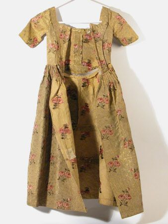 Back view, girl's dress (aged 6 years), 1750-1770. Mustard yellow silk brocade…