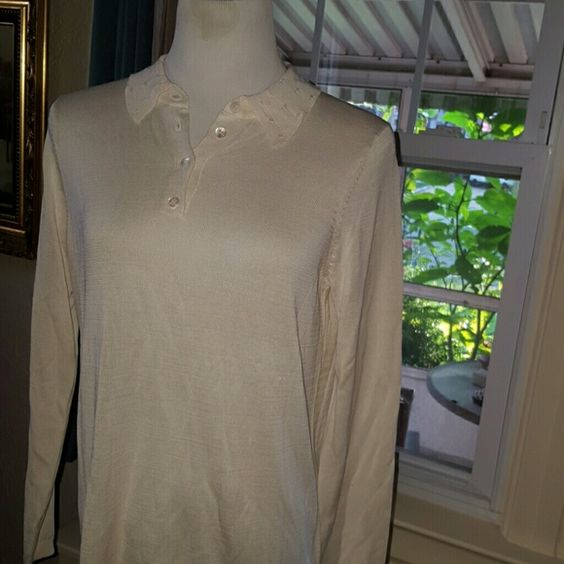 NWOT Orvis silk eggshell top M This is a silk top. The  buttons are gorgeousas is the cable on the collar. Even the bottom is finished beautifully. It does have the extra button hanging on it. Orvis Tops