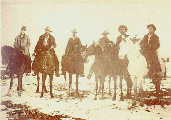 Extremely rare photo of Billy The Kid when captured at Stinking Springs, December 24th 1880. Pat Garrett is clearly recognisable extreme left and Bob Olinger is next to him. Billy is on the extreme right where a deputy aims a Colt revolver at Billy's head. One of Billy's compadres, Charlie Bowdre, had been killed in the encounter.