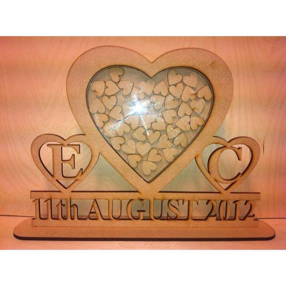 Stunning wedding guest book alternative and totally unique. Your guests simply write their message on a heart and drop it into the frame. A