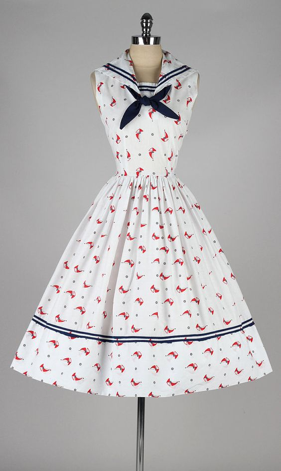 """A sailor collar is a classic touch, as is the white and blue and red color scheme. Notice the overall """"crisp"""" feel to this dress. Yes, it's a full skirt, which reads feminine - but this is a brisk, efficient feminine."""