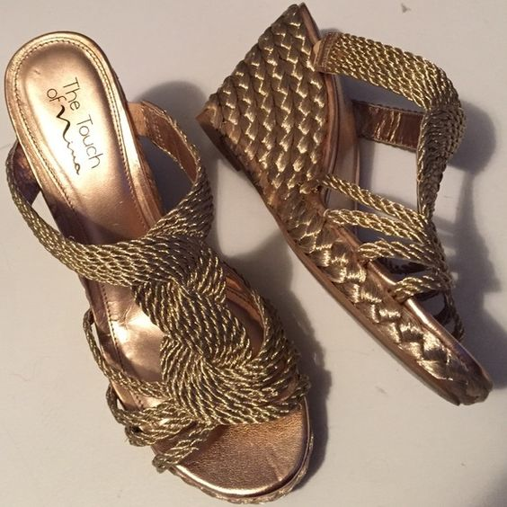 """Like new Nina wedges Gorgeous gold 3 1/2"""" wedges (1"""" platform). Beautiful woven design on straps. Slightly padded footbed for comfort. Worn once. Smoke-free/pet-free home. Nina Shoes Wedges"""