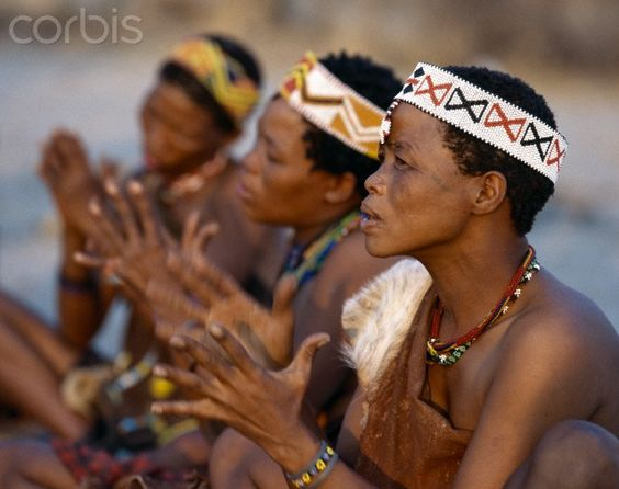 Kung women sing and clap their hands to the rhythm of their menfolk. The Kung are San hunter gatherers, often referred to as Bushmen.The Kung live in the harsh environment of a vast expanse of flat sand and bush scrub country straddling the Namibia B