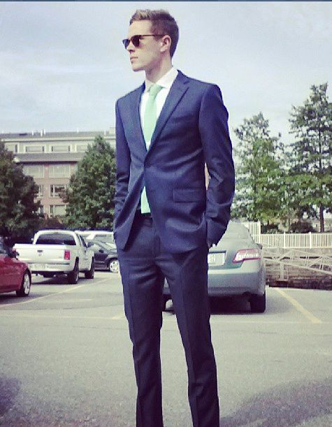 Business below with a fitted navy blue suit with a pastel green ...