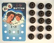 """50's Tip-Top Button Curlers. Lot of 15 brown flexible vinyl 1"""" spool pin curlers. The curlers are used and a little dirty."""