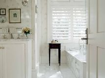 Whether traditional marble rocks your world or romantic skirted vanity seats set your heart aflutter, there's a white bathroom for you