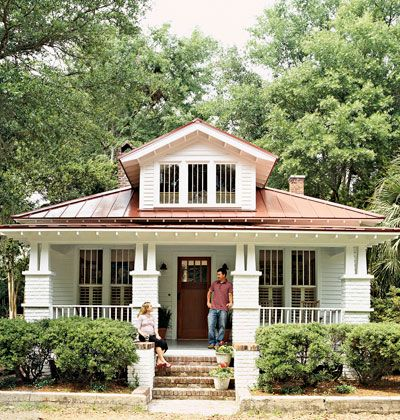 Love this cottage home with the metal roof. I could so see myself sitting on that porch.