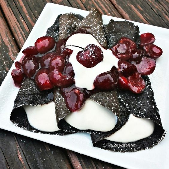 Dark Chocolate Black Forest Cake Crêpes with vanilla protein yogurt and fresh cherries ~~~~~~~~~~~~~~~~~~~~~~~~~~~~~~~~~~~~~~~ I love, LOVE German Black Forest Cake: chocolate cake layered with whipped cream and cherries.  What's not to love, besides the calories!?!?  These are a nod to the original cake, made healthy! These crêpes have all the dark chocolate cake flavor, that is filled with a vanilla protein yogurt and topped with a fresh cherry sauce that's to die for! All #wholesome