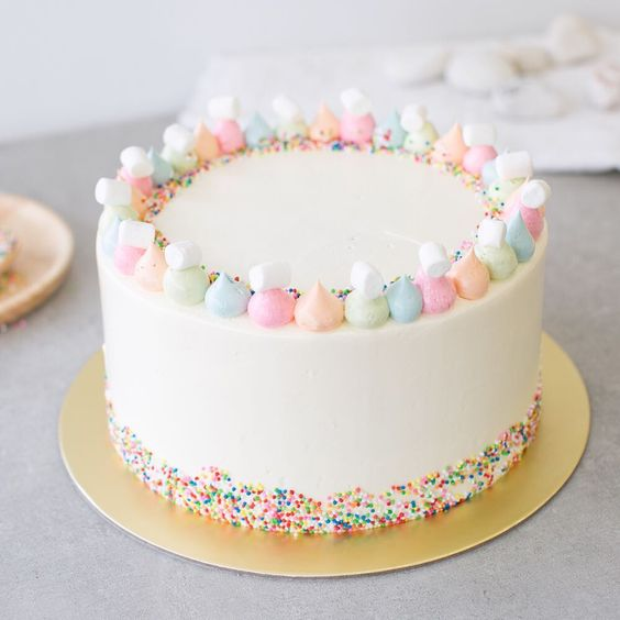 """Baker's Brew Studio on Instagram: """"Funfetti Vanilla Cake • A simple vanilla sponge cake, frosted with vanilla Swiss meringue buttercream, decorated with marshmallows and…"""""""
