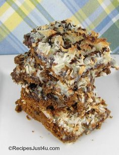 These Chocolate Coconut Hello Dolly Bars are very easy to make and perfect for a pot luck dinner.  Your family will ask for them again and again. recipesjust4u.com