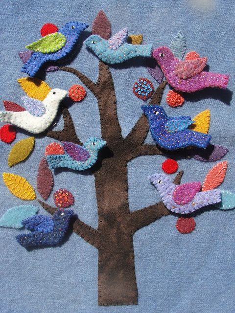 this could be turned into a cool interactive toy/art piece--tree is sewn on, then put velcro on the back of felted birds, squirrels, leaves, fruit, etc.