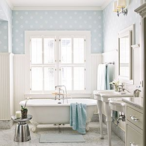 polka dot with white accents in bathroom. southernliving.