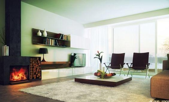 murs vert pâle et une cheminée élégante dans le salon minimaliste