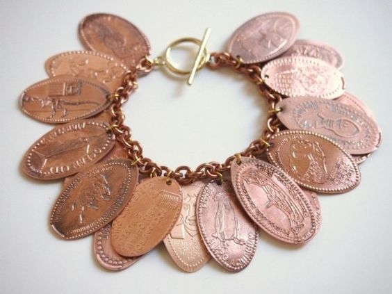 souvenir pressed penny bracelet-wish I had saved all the pressed pennies I had as a kid. I think I'll have to start collecting again:); every time we found one of these machines when we were dating, we'd make pennies! I have so many! Finally have a way to use them (KLH)