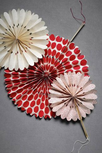 Imagine fans like these at each place setting. or on each chair at the wedding. Make them from paper that goes with your theme. Beautiful, colorful, useful!