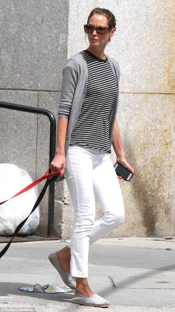 Casual chic: The 45-year-old supermodel sported a black and white striped top, teamed with white denim capris that highlighted her long slender legs