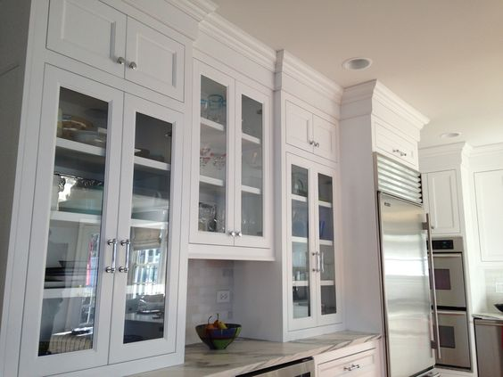 Brand new cabinets with glass doors.