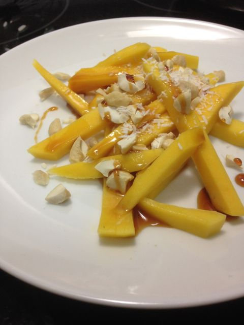 Mango salad with raw cashews, coconut flakes, and coconut nectar.