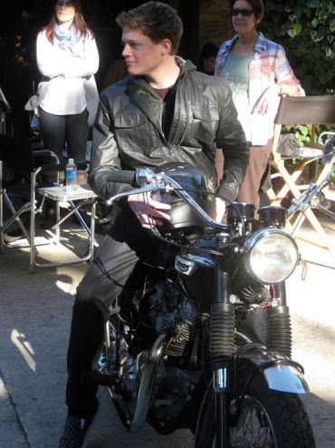 I wonder if he does ride a motorcycle it really fits him!!! It makes look even better and more cool!!!