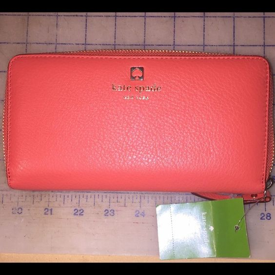 ✨ON SALE TODAY✨orange leather Kate Spade wallet Amazing wallet beautiful soft leather. Tons of cars spaces. Extra space for anything you want to carry kate spade Bags Wallets