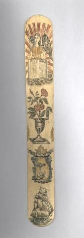 """Material: Whale skeletal bone Date: 19th Century Basis style Pigment: Black, red, gold Tool used: knife Design: Face Top to bottom: Angel holding Holy Bible, urn with roses, seal of Rhode Island with word """"Hope"""" over anchor, sailing ship. Providence Public Library"""