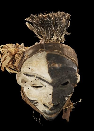 mask  Materials wood, feather, raffia, pigment  Pende  Date of acquisition 1930-10-20  Dimensions 34 cm x 26 cm