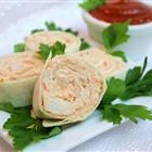 Crabmeat Roll-Ups Recipe, tortillas filled with crabmeat, cream cheese, green onions and cocktail sauce yummy!