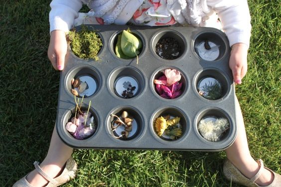 little girl holding muffin tray