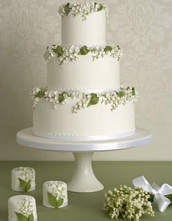 fab three tiered cake with Lily of the Valley detailing but it's those sweet little mini cakes that catch my eye.