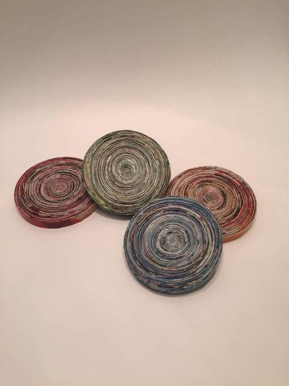 Red blue orange and green coasters. #coasters #magazinecoasters #recycled #recycledmagazine