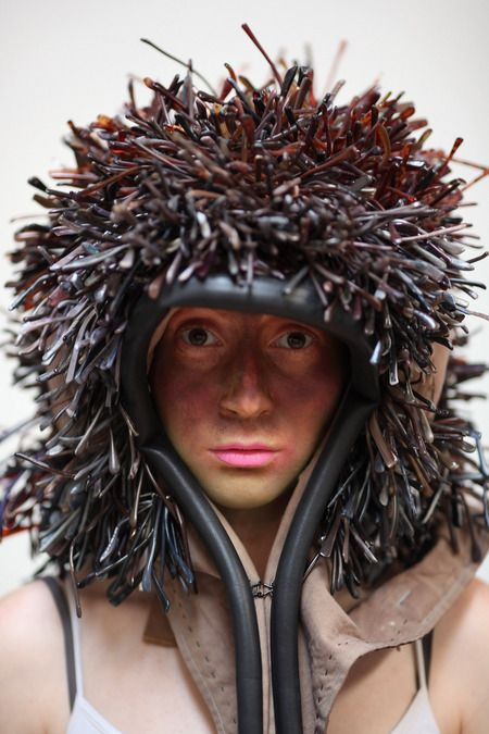 A model wears 'The Temple Tip Bower' by Stuart Haygarth & Sian Evans during a fashion show and auction at WWF Pandamonium 2012
