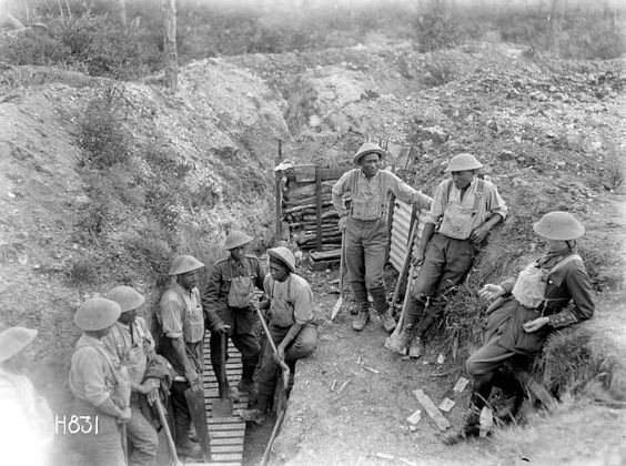 Members of the New Zealand (Maori) Pioneer Battalion take a break from trench improvement work, near Gommecourt, France, 25 July 1918.
