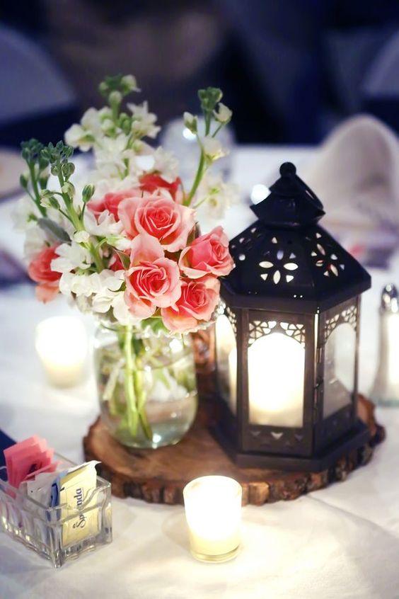 rustic wedding ideas-pink roses in marson jar with black lantern