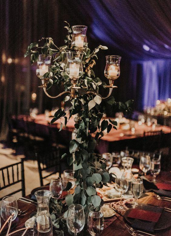 Beautiful earthy candle abra centerpieces #florafetish #candle #abra #centerpiece #class #wine #water #light #purple #green #eucalyptus #silverdollar #best #nikknguyenphoto #tracycollinsevents #austinweddingflorist #austineventflorist