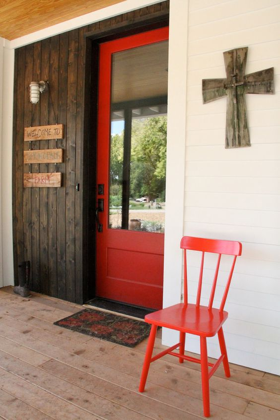 Graceful Red Door house designs Farmhouse Entry Austin home insurance cross dark stained wood door entry mat front glass door lantern sconce red red chair red door Welcome Sign white exterior wood deck - Decorcology.com