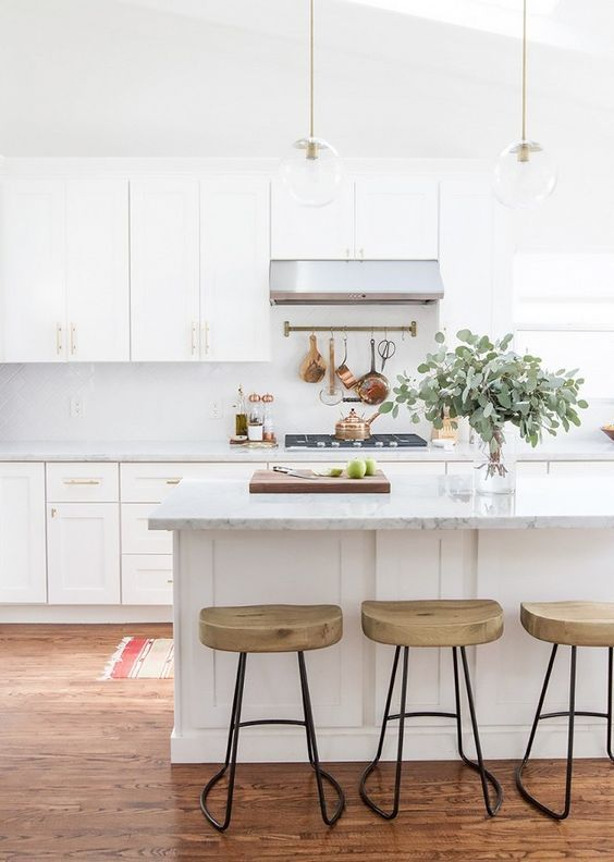 Bright all-white kitchen with marble countertops
