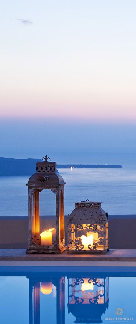 Lanterns by the swimming pool in the evening at the Gold Suites Santorini