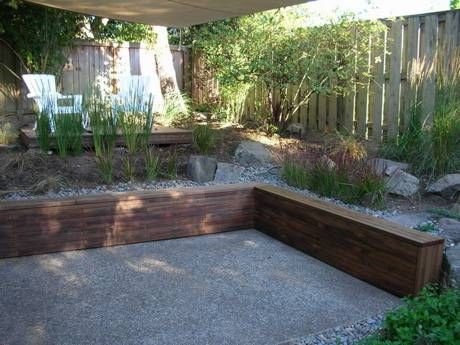 gravel patio wooden retaining wallbench