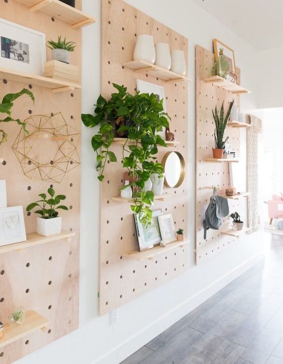 Display all your keepsakes in a fab pegboard-covered hallway.